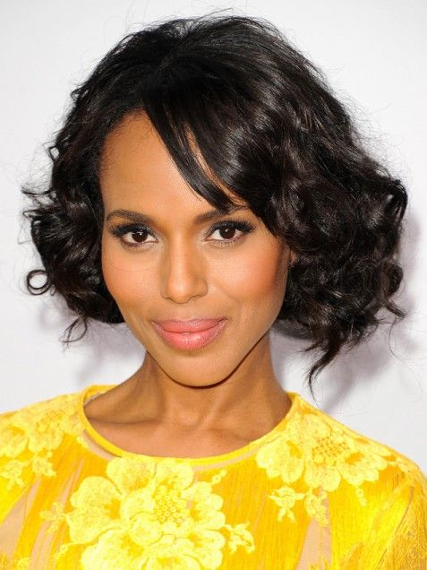 Kerry Washington | Side-swept bangs and natural curls bring softness to Kerry Washington's bob. Create a side part and blow dry just your bangs straight. Use a curling iron to blend some defined ringlets within your natural curls. via @stylelist