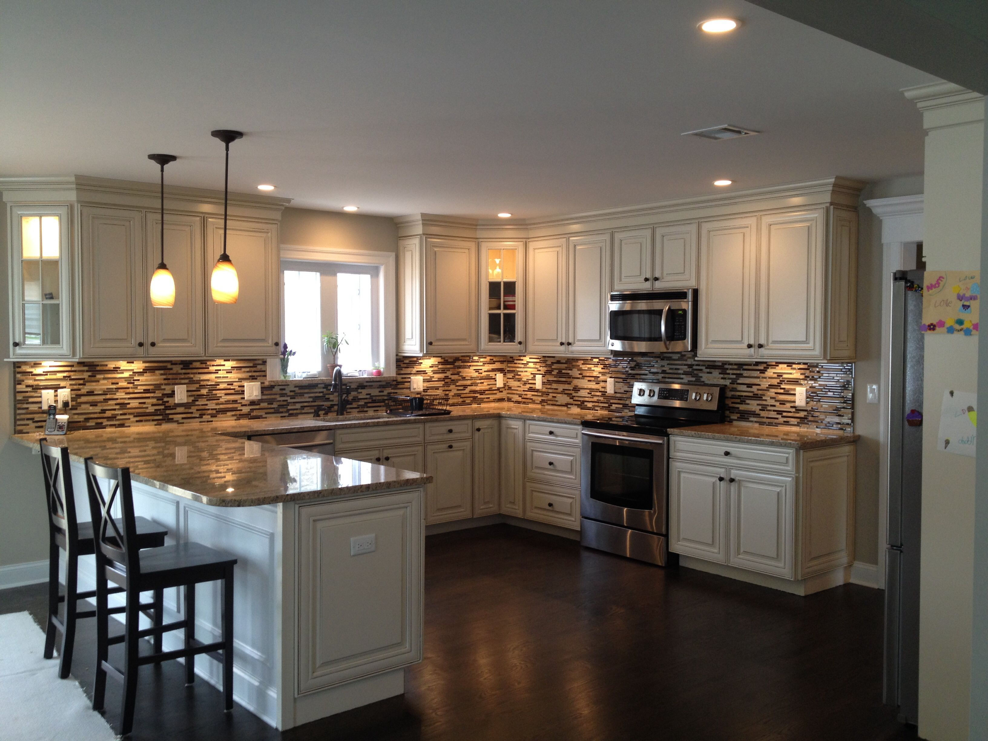U shaped kitchen with peninsula design with American