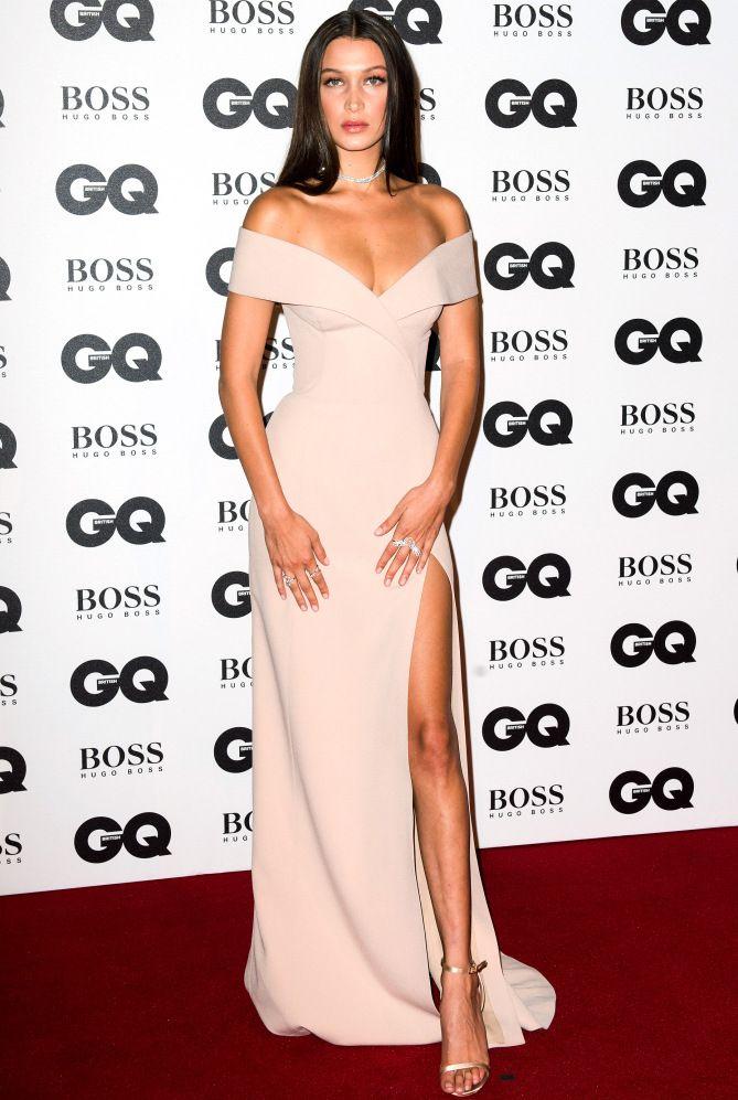 6e2bd57abdbf Bella Hadid in a cream Jason Wu for Hugo Boss off-the-shoulder dress