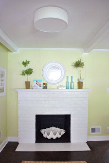 A Clean Flush Mounted Light Near The Fireplace Ceiling lamps