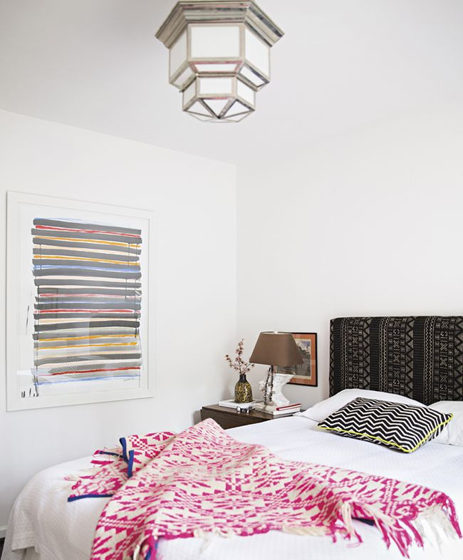 A neon throw and pillow piping brighten's up Sally King Benedict's bedroom • via @SavvyHome