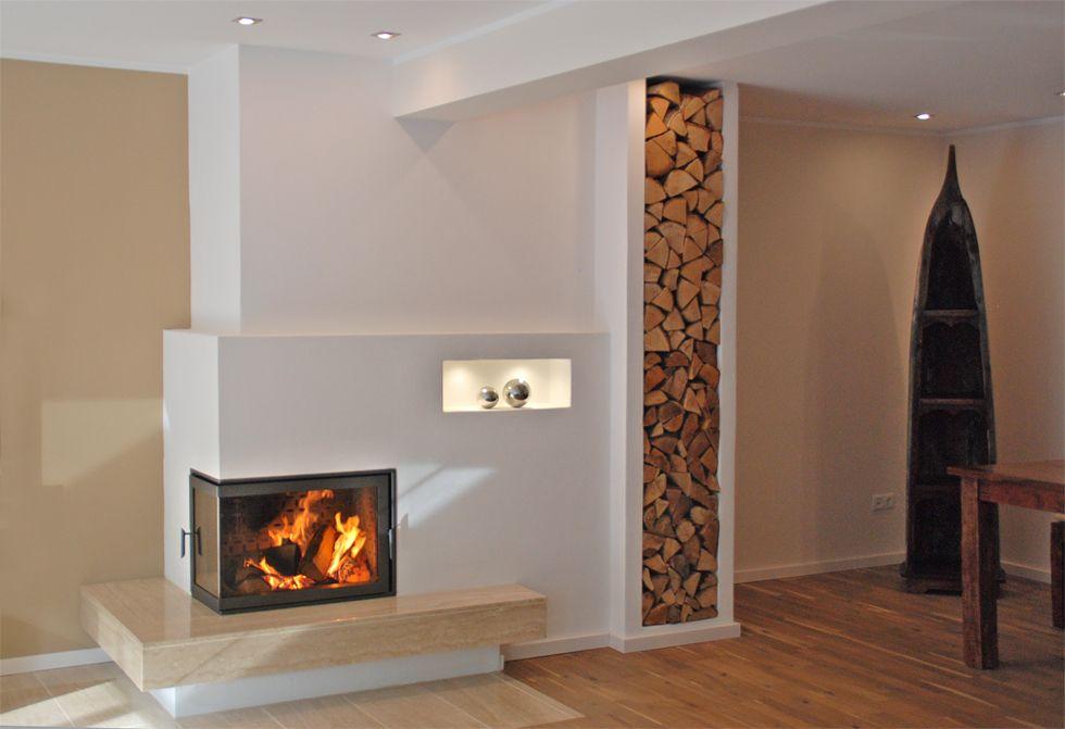 AMBIO Design Kachelofen Kaminofen  gestapeltes Holz als integrierter Bestandteil  Hingucker