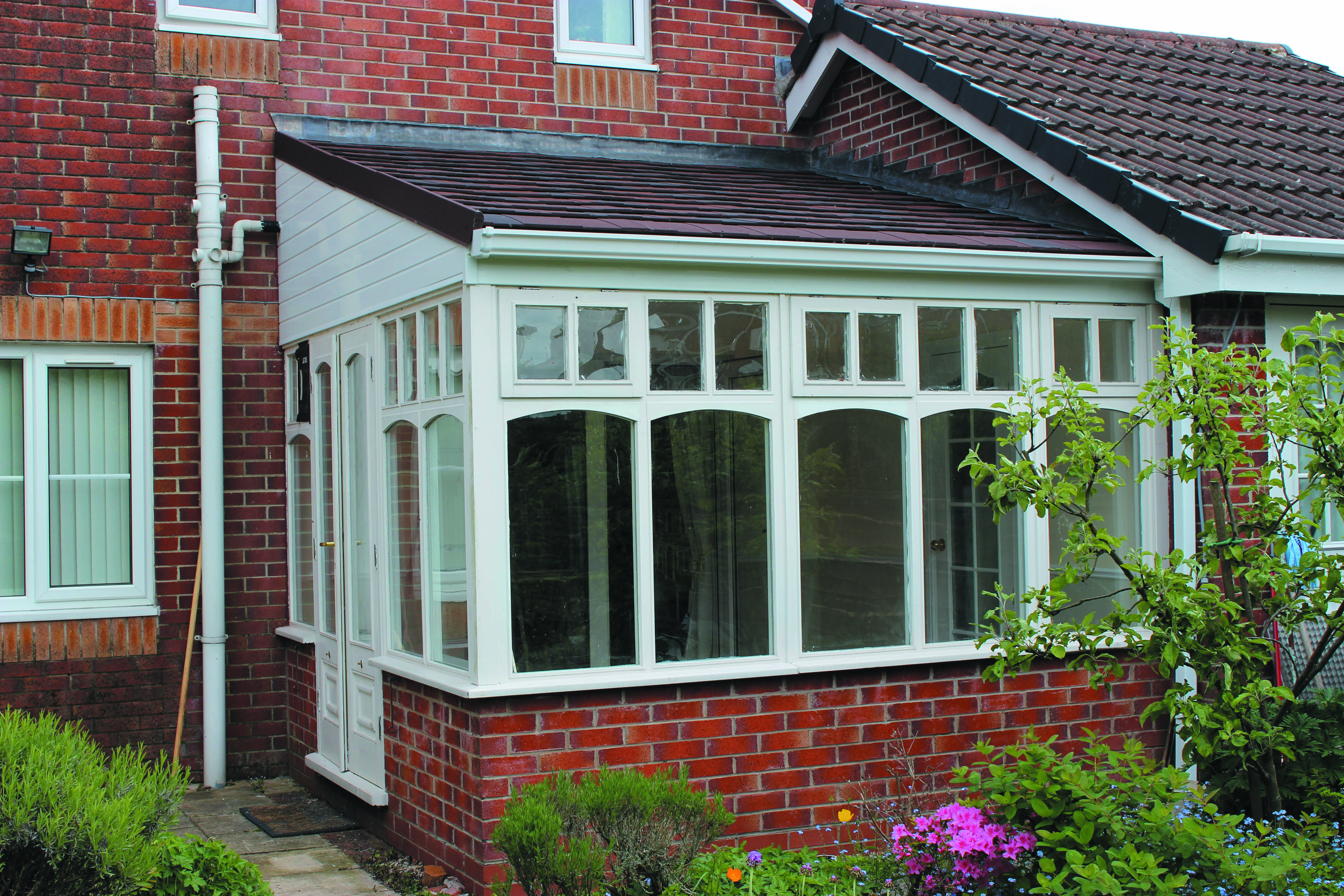A Small Lean To Conservatory Roof Which Is Neatly Matched