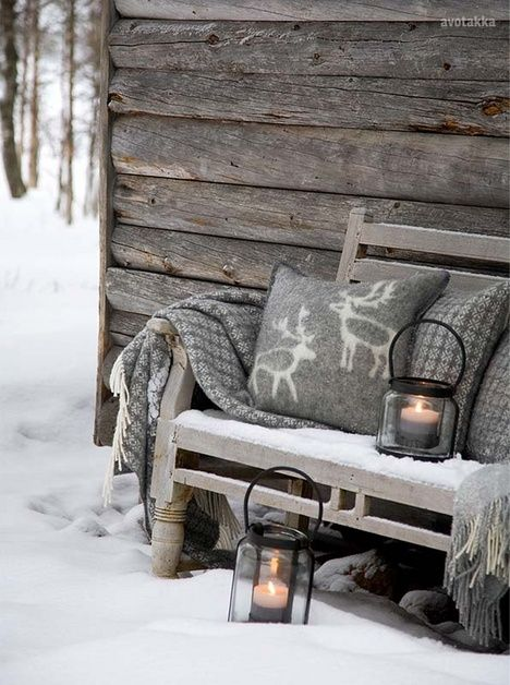 Winter Wood Bench With Grey Cushions And Throw And Black Lanterns