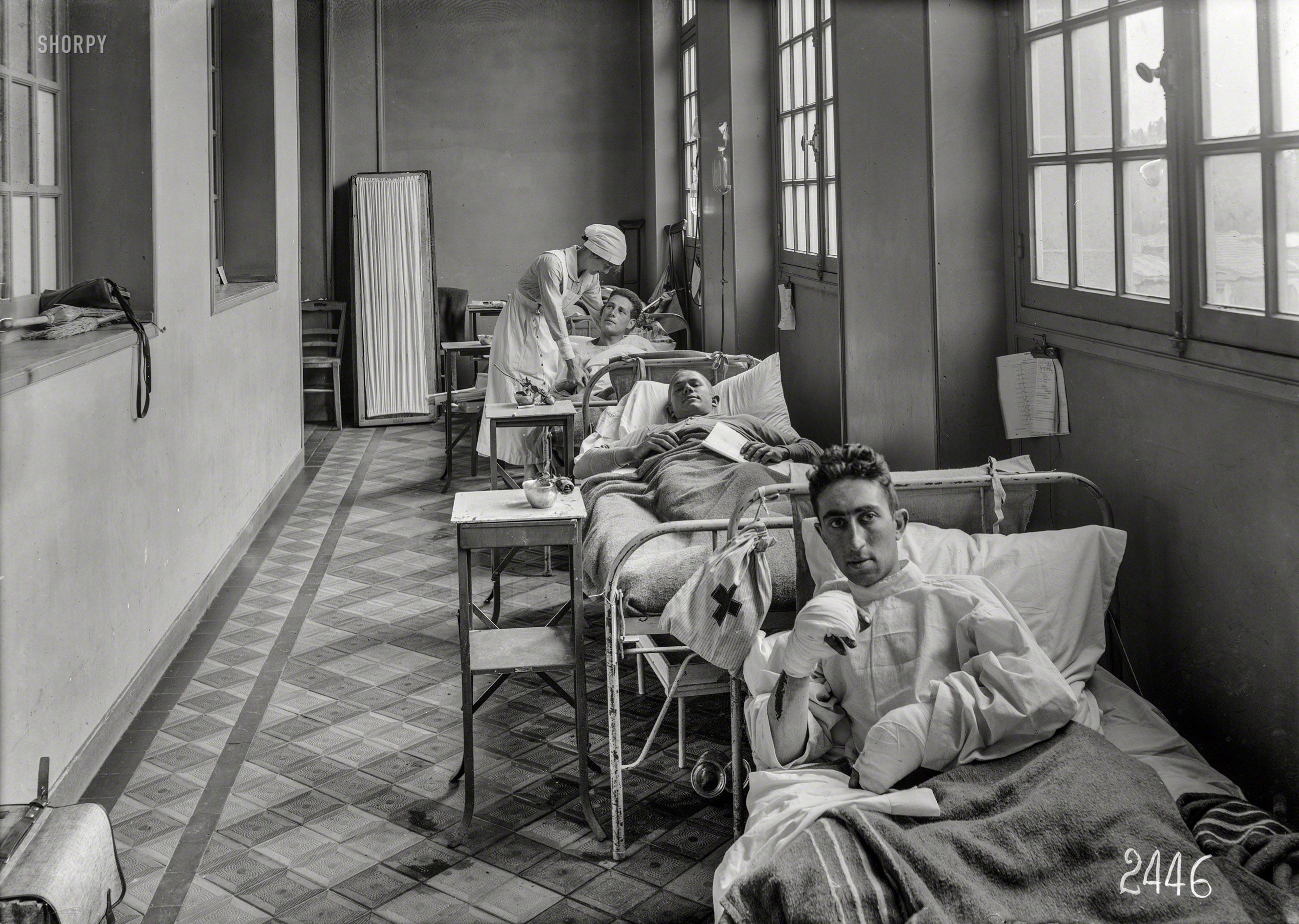 """WORLD WAR I: June 14, 1918. """"Scene in corridor of American Military Hospital No. 1 at Neuilly, France."""" Photo by Lewis Hine for the American Red Cross."""