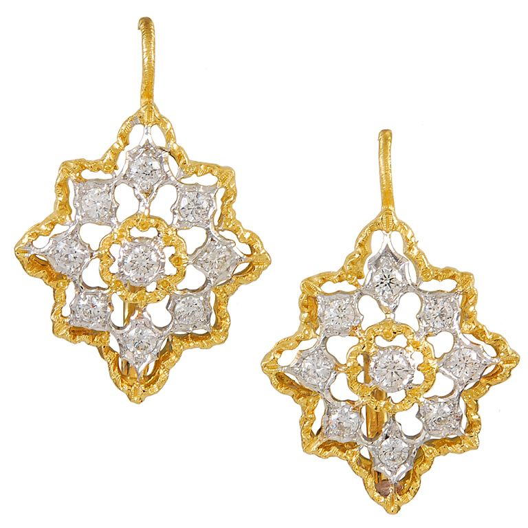 Delicate M.Buccellati 18k gold drop earrings set with 9 faceted diamonds. Lovely pierced work, typical of Buccellati. Circa 1950's.