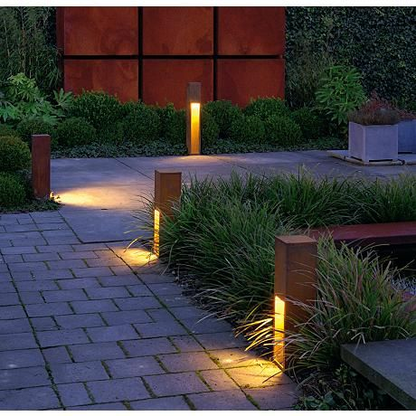 The Rusty Slot Outdoor Bollard Features A Sleek Column With