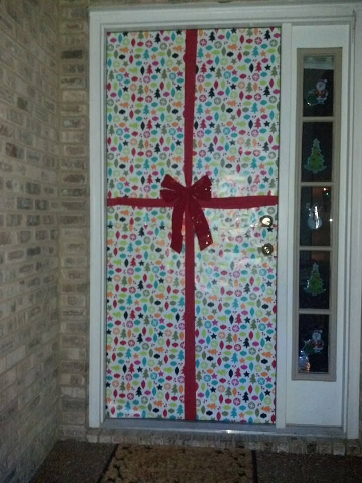 Use Wrapping Paper And Cover The Front Door Use Red Streamer And