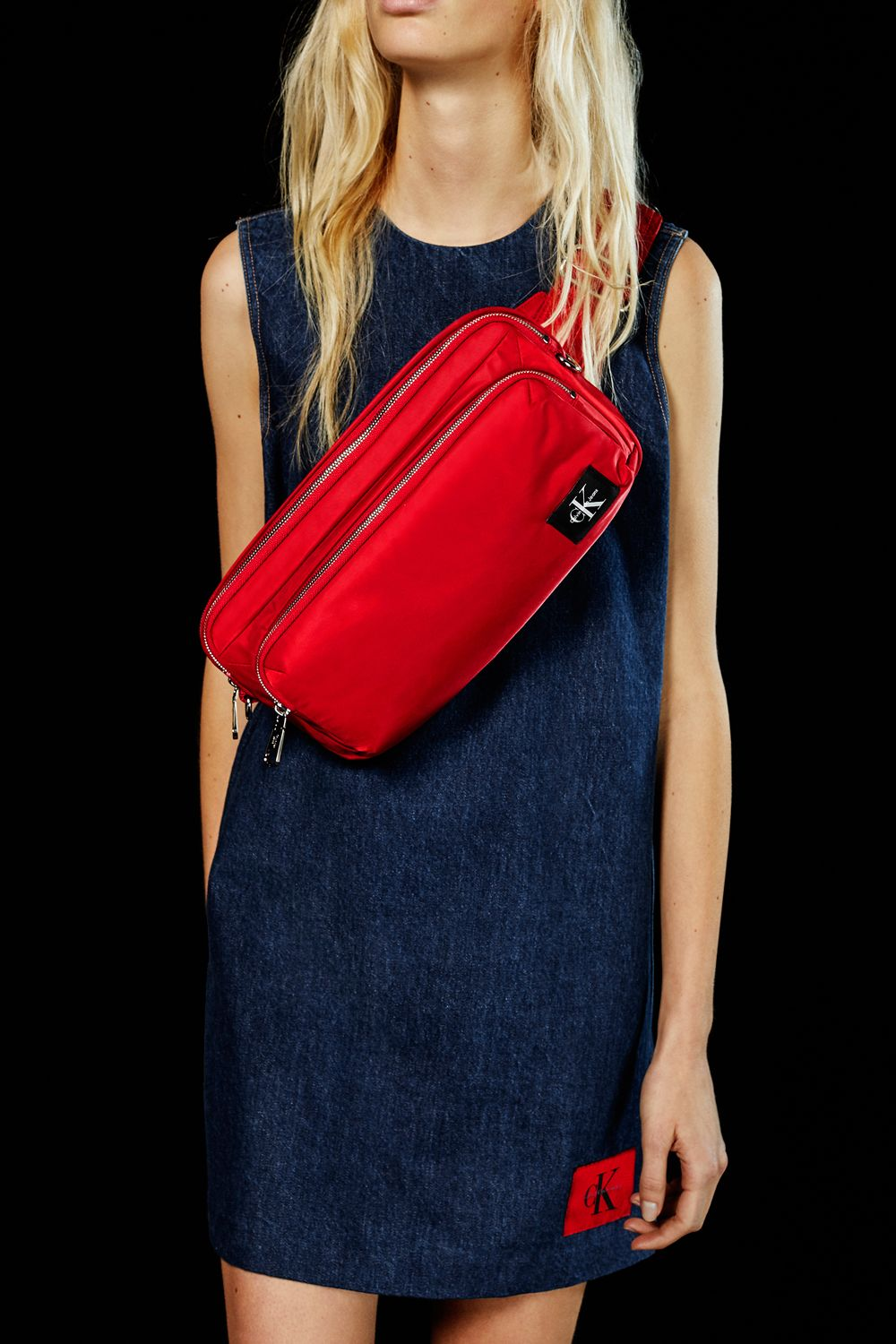 e09713fcc5b41 On the go  the crossover sling bag from Spring 2018 CALVIN KLEIN JEANS  features a heritage logo patch and lightweight sling for quick access to  your ...