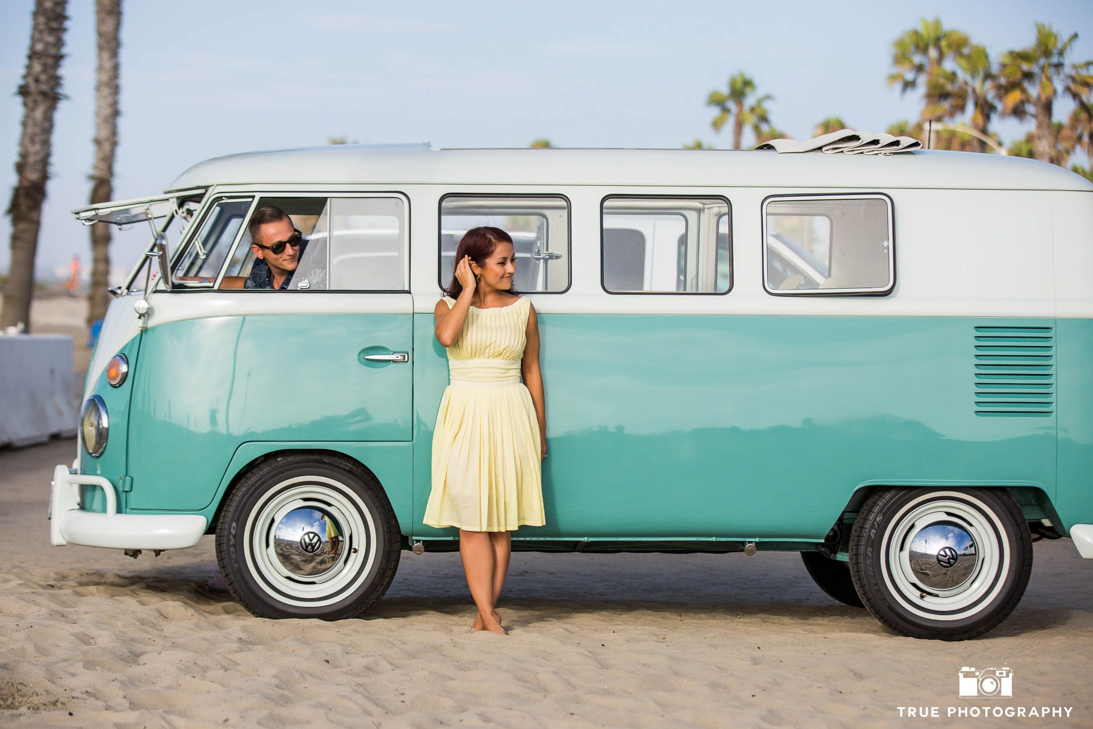 bride to be stands outside vintage volkswagen bus while. Black Bedroom Furniture Sets. Home Design Ideas