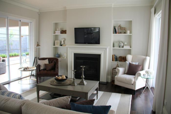 New Hampton » Charleston Homes love the chair beside the fireplace