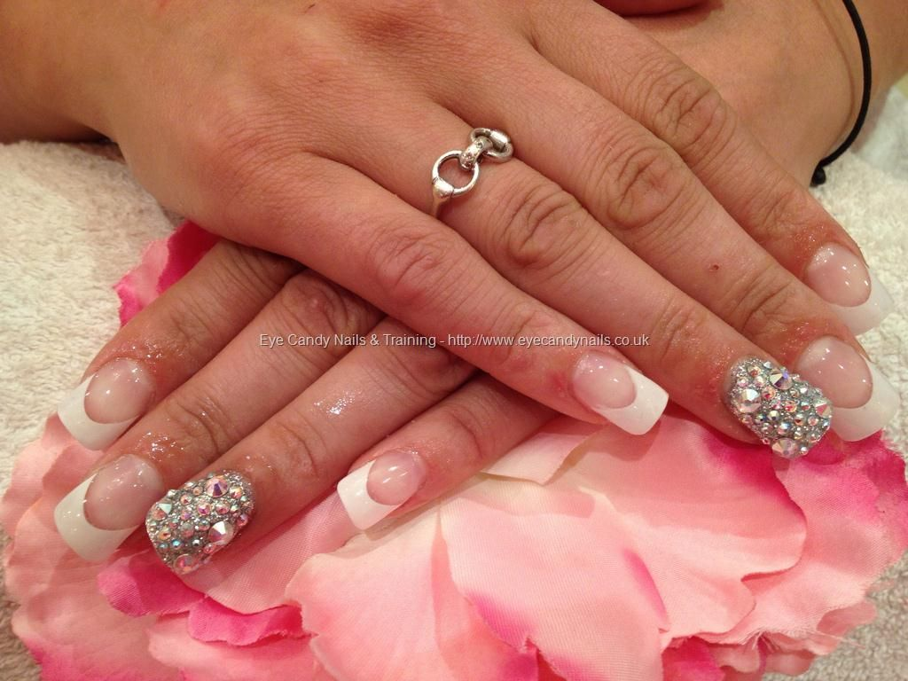 Full set of acrylic with white tips and Swarovski crystals on ring