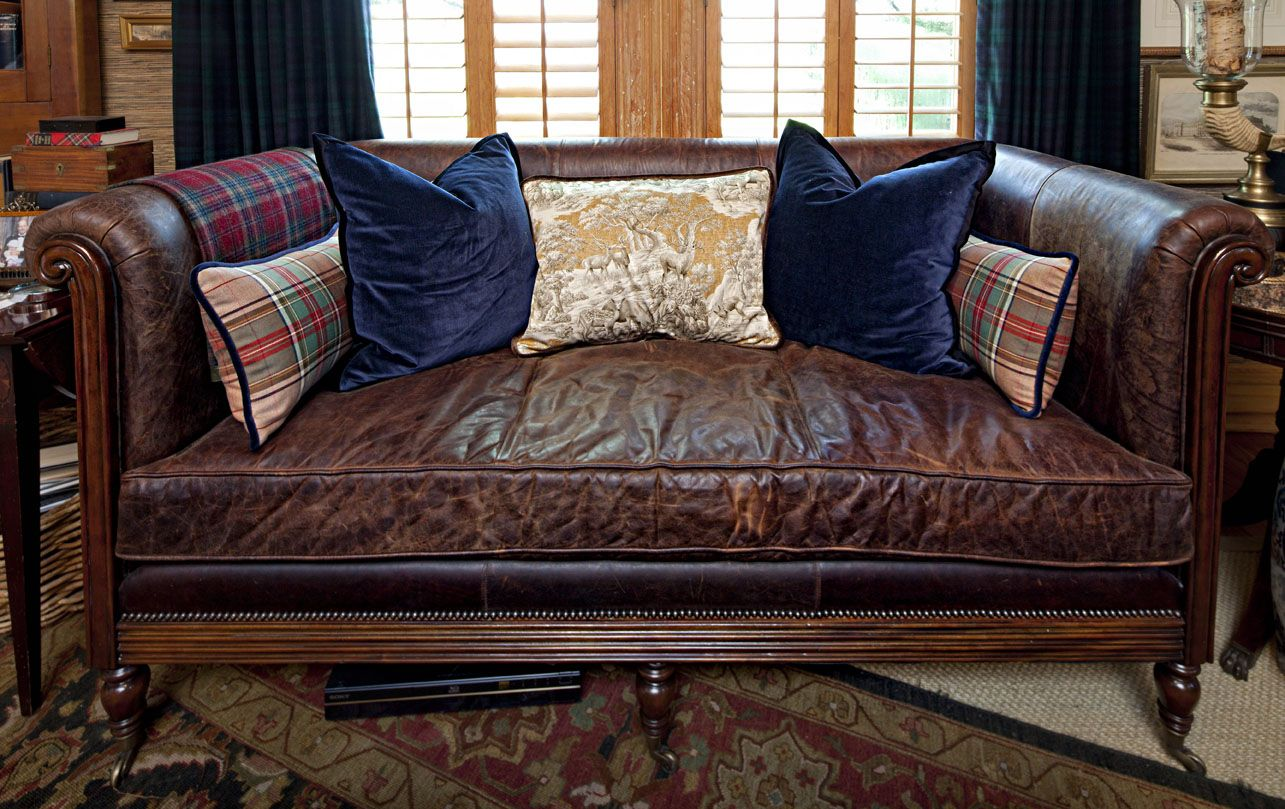 Classic brown leather sofa/settee with single seat cushion