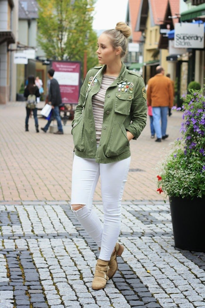 ripped white jeans and an embellished parka