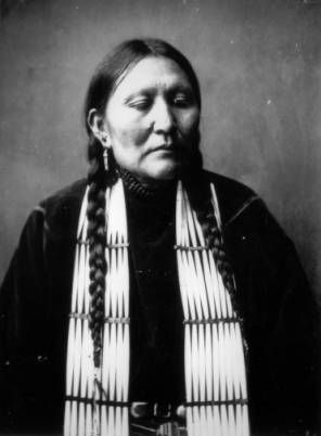 Shee-Moo, Blackfoot squaw:  CREATED/PUBLISHED  1907  Studio portrait of a Native American (Salish) Flathead (possibly Blackfoot) woman, identified as Sheemoo. She is dressed in dark clothing which is accented by the hair pipe ornamentation around her neck.