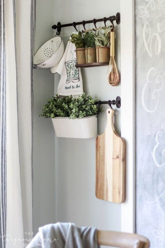 The IKEA Fintorp Rails hanging system is perfect for adding interest and dimension to any plain ol  wall  Great farmhouse decor wall vignette idea #homedecor #diyhome