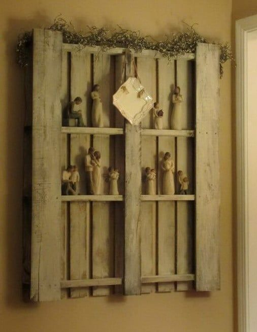 A beautiful wall storage shelving unit made from a pallet