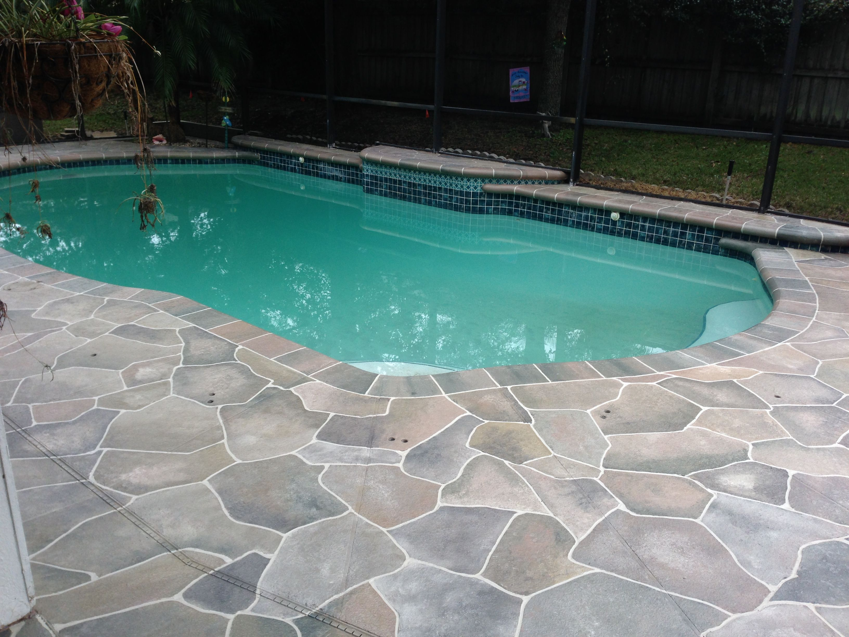 concrete pool deck ideas | concrete flagstone simulation pool deck