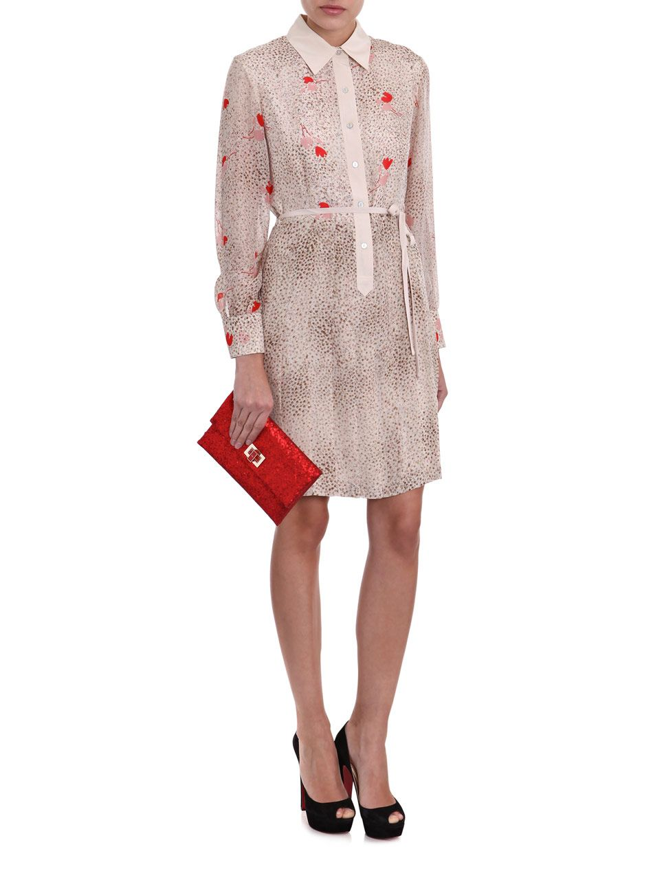 Update your evening repertoire with this matt-red Valorie glitter envelope clutch from Anya Hindmarch. Carry with a floral-print dress for a high-contrast finish. Styled here with Raoul dress and Christian Louboutin pumps.
