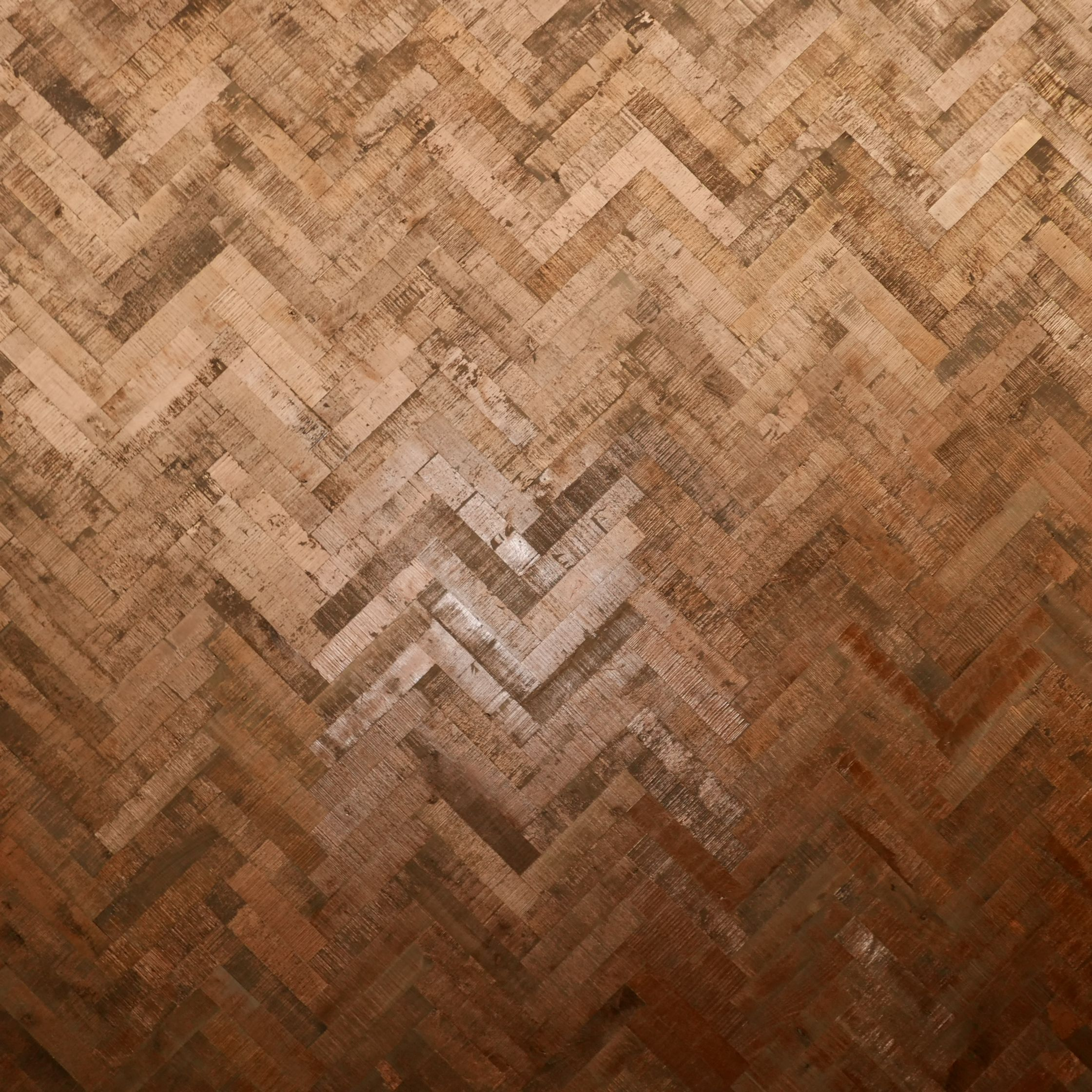 Copper Herringbone parquet flooring by Ted Todd, as seen