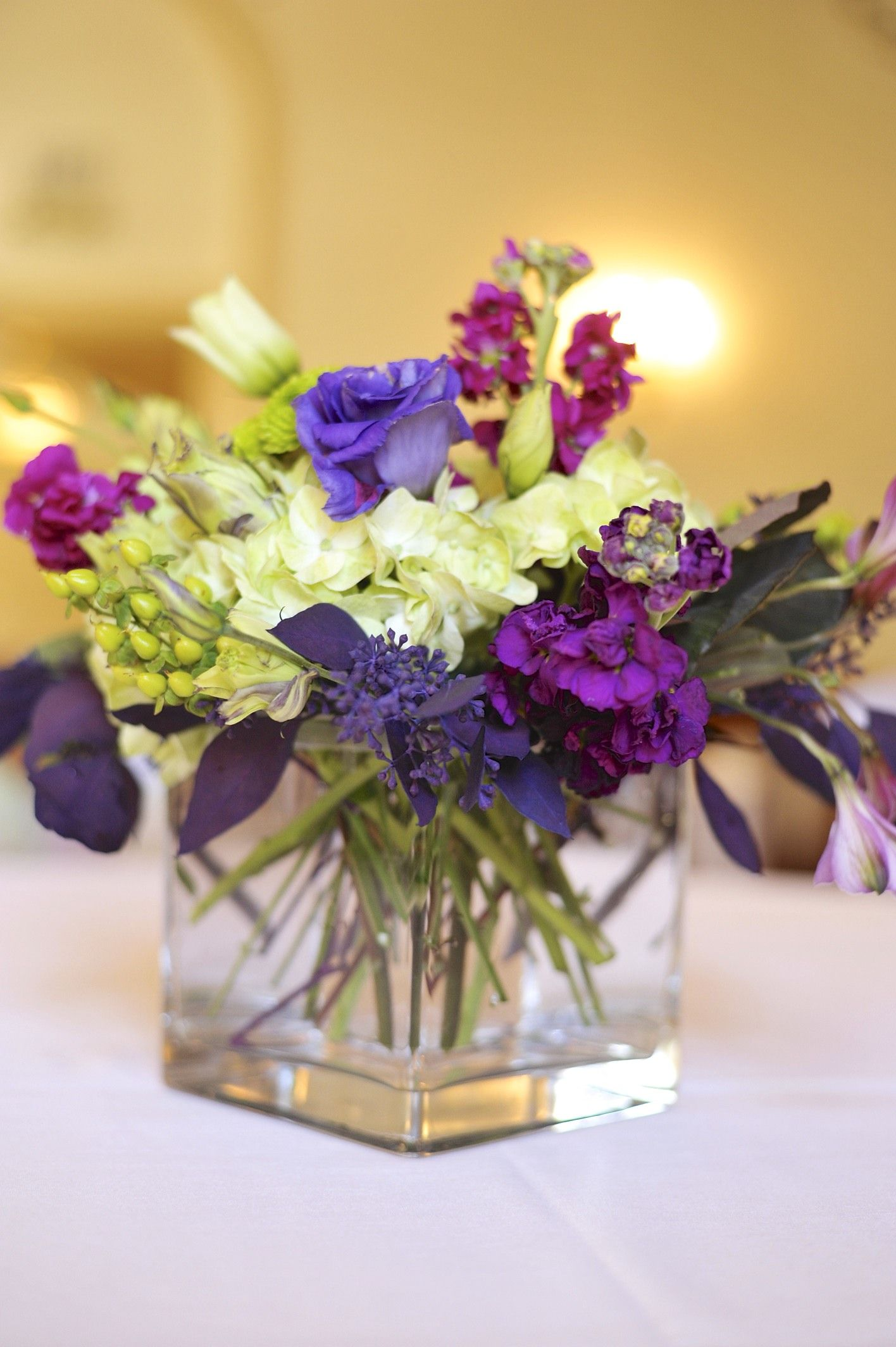Traditional purple lime green wedding centerpiece utah