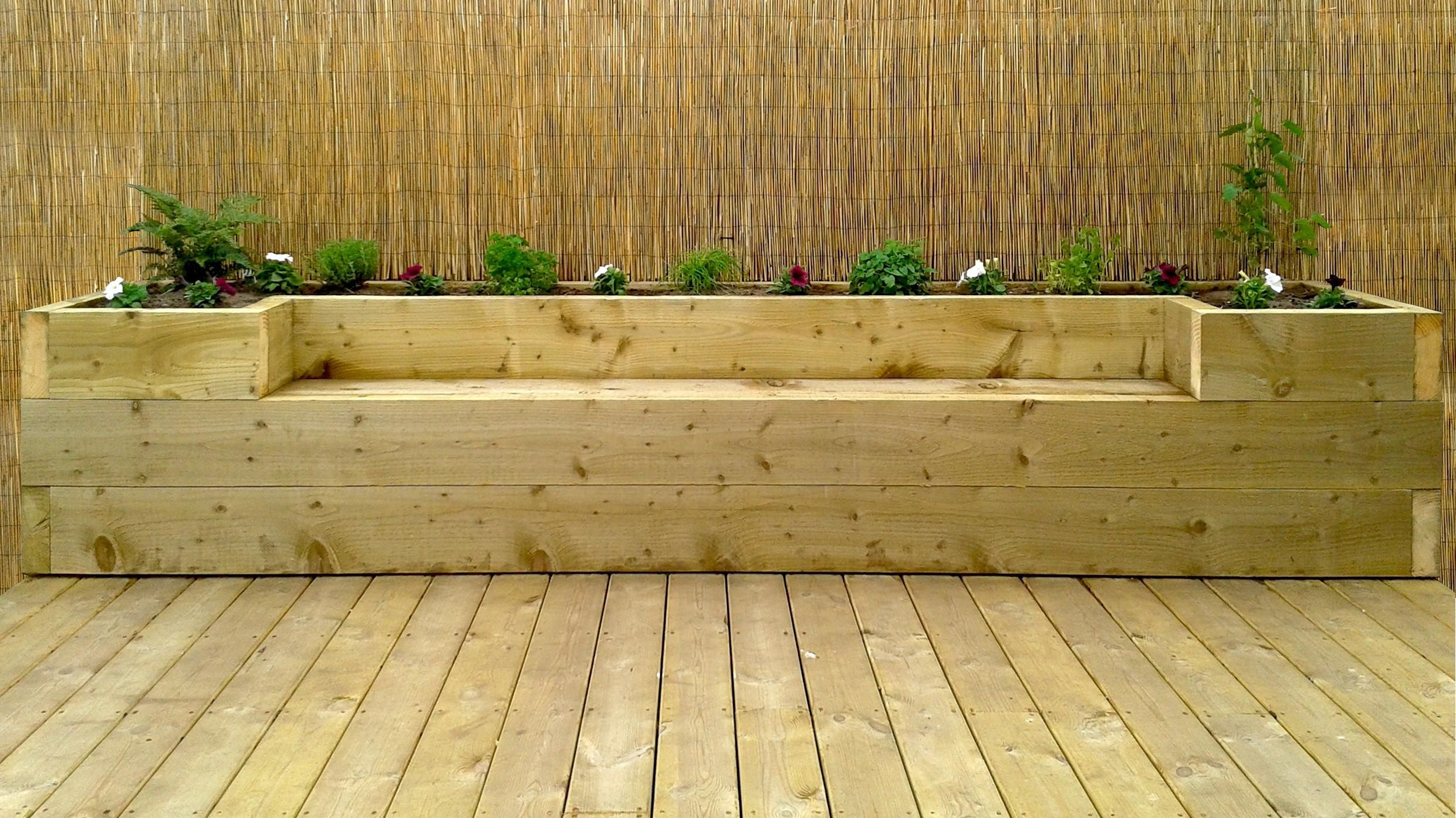 Raised Flower Beds Along Fence With Seating