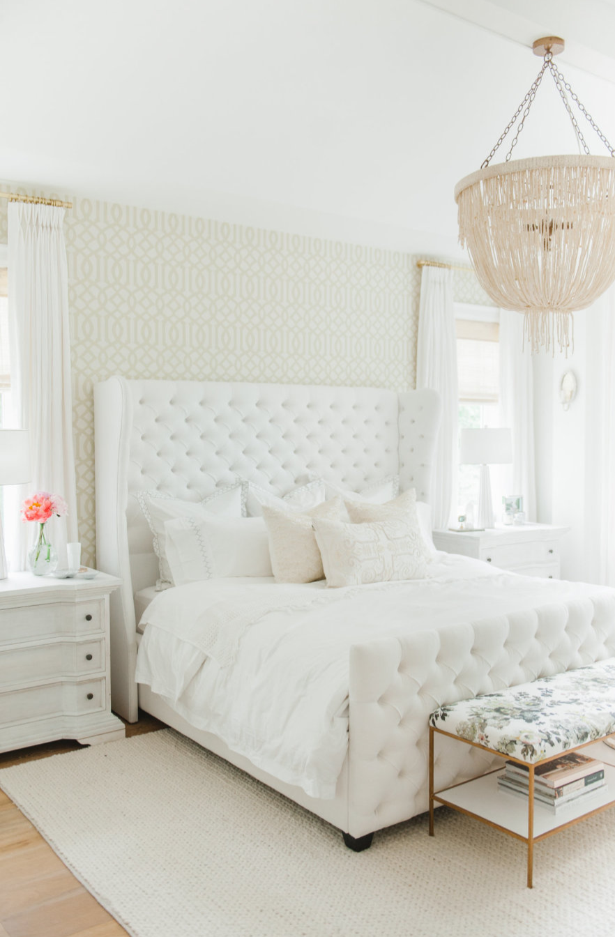 This all-white bedroom from Abby, of Style Me Pretty, might not use many paint colors, but it's packed full of style. Ultra Pure White and Polar Bear work together to create a neutral color palette. Meanwhile, details like this tufted headboard, chandelier lighting, and wallpaper focal wall add a burst of chic style.