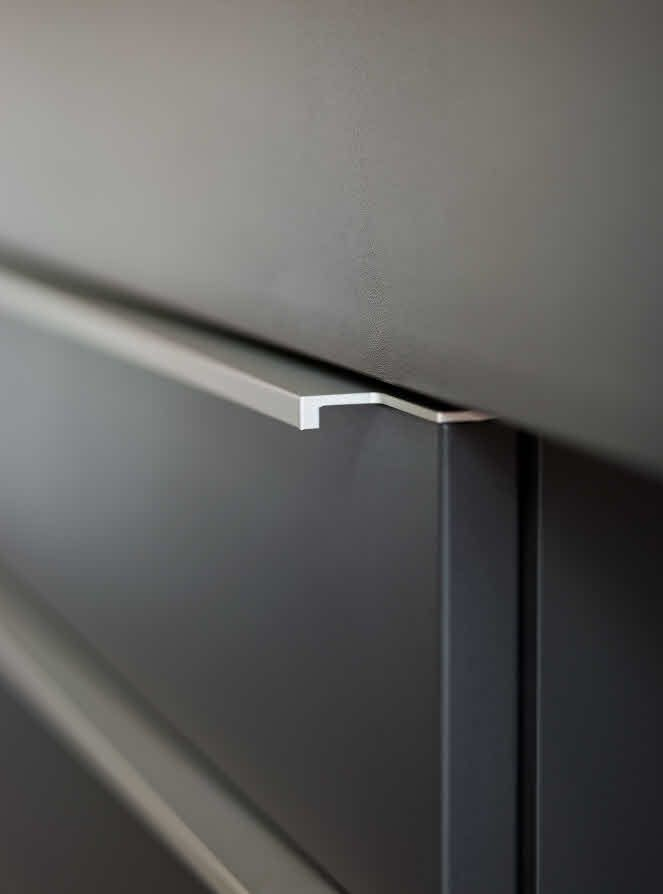 The Sleek Handle Defines The Cabinets And Drawers Silhouette Of