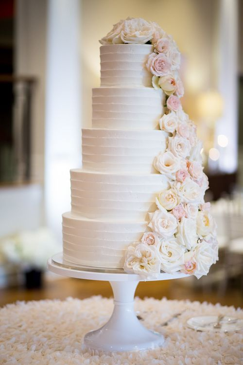 White Five Tier Wedding Cake With Cascading Roses Bridal Bliss
