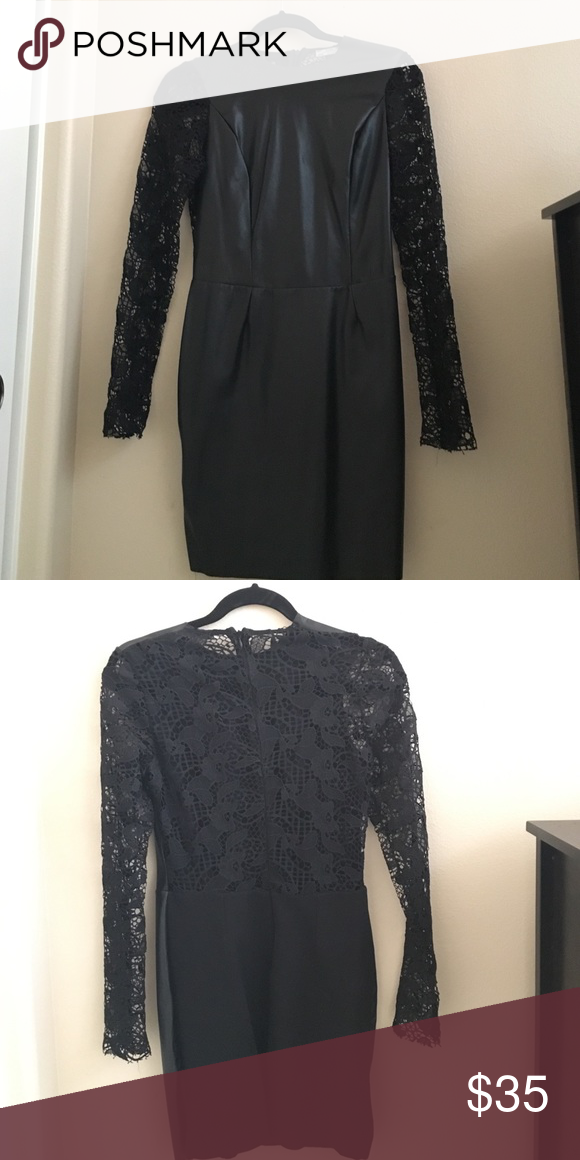 Gorgeous leather and lace dress This gorgeous black dress is very unique. The front is faux leather and the back and sleeve is all lace. Extremely chic and elegant , one of a kind Zara Dresses Midi