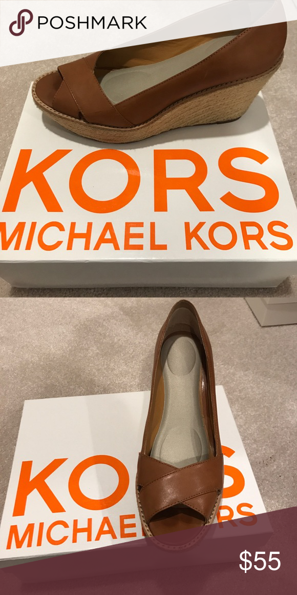 Michael Kors brown leather wedges Light brown leather wedges with cross cross at the toe. Comes wih a padded insole! Gently worn in GREAT condition!! KORS Michael Kors Shoes Wedges