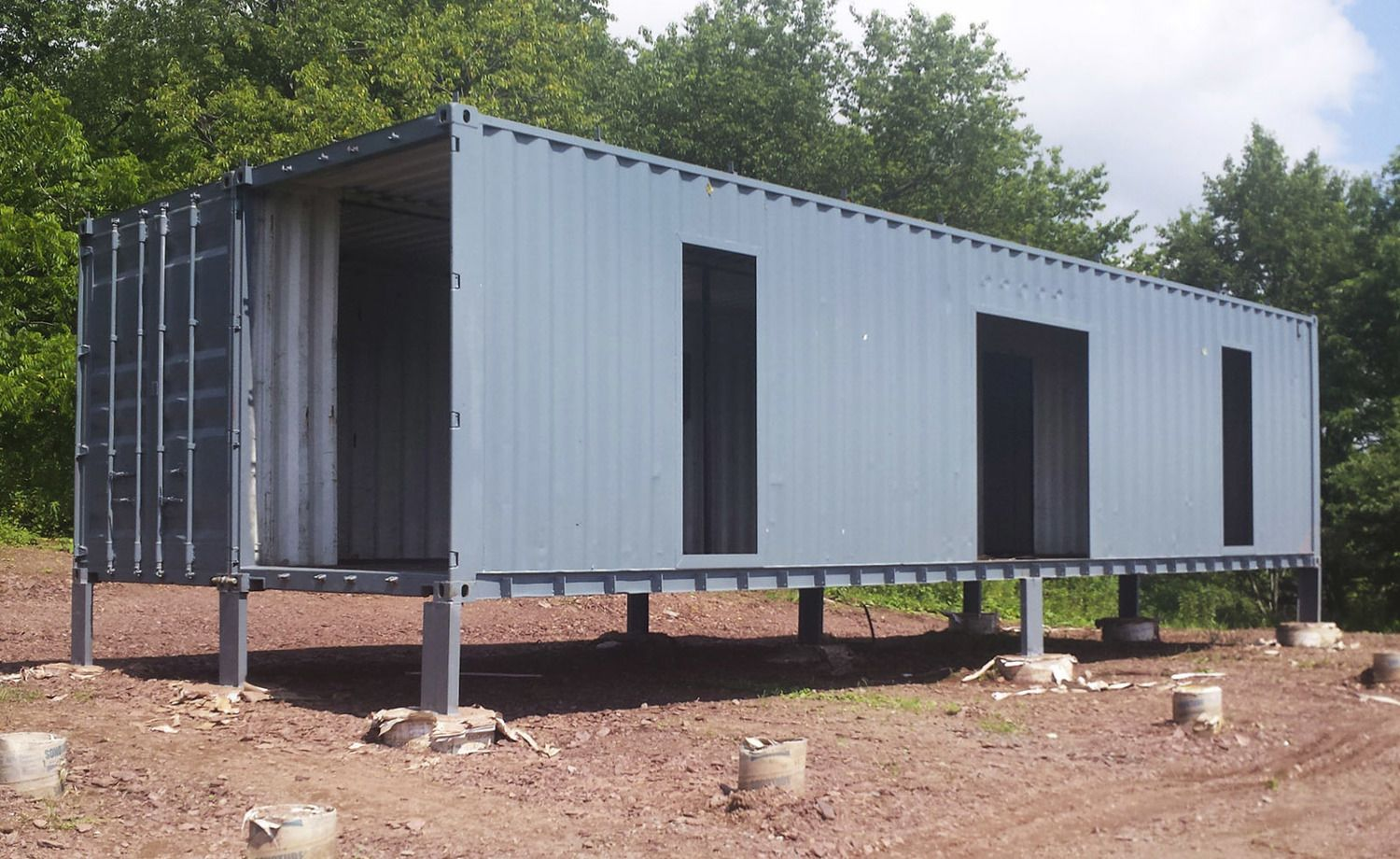exterior view of 2 shipping containers joined together sitting on rh pinterest com