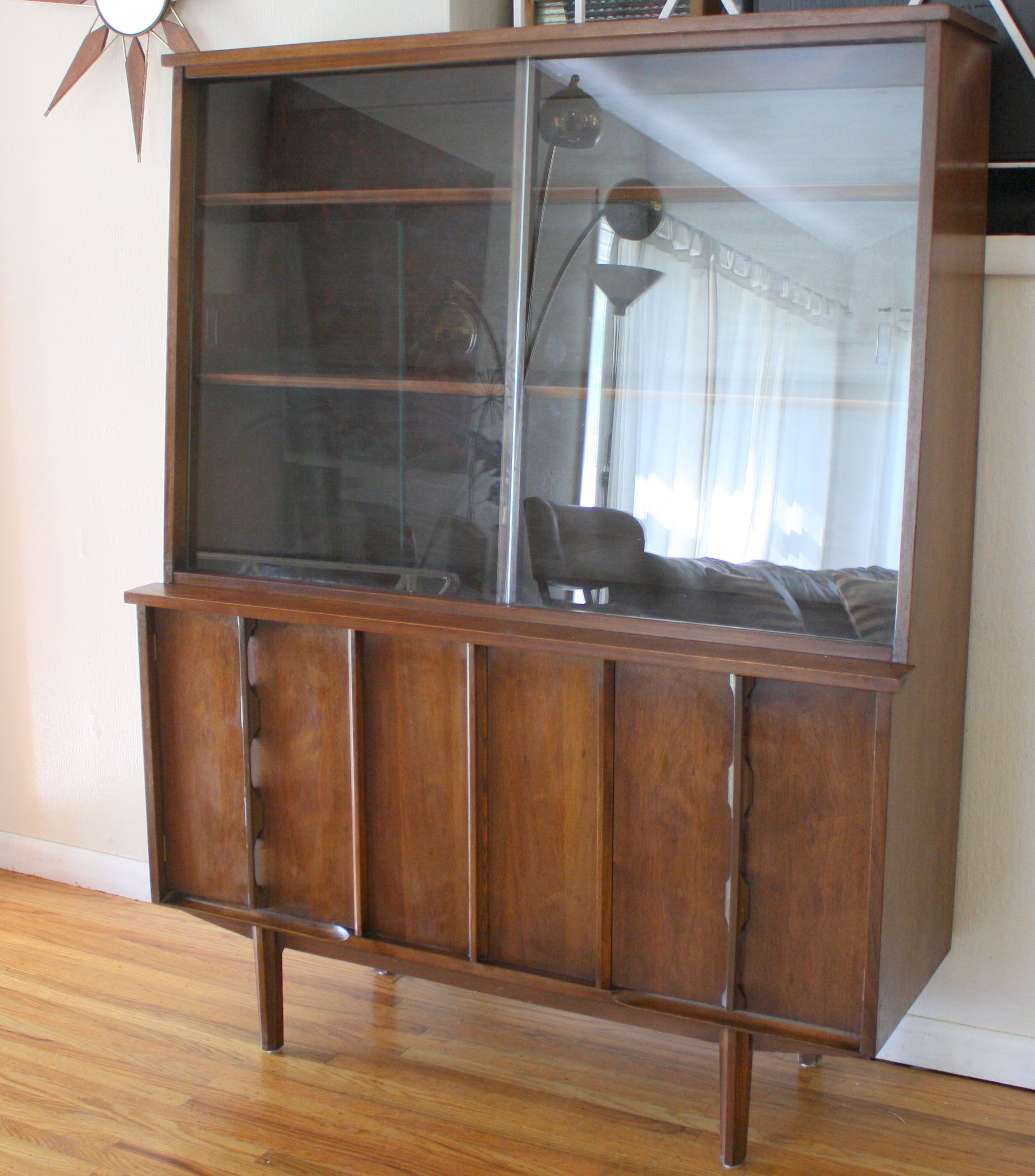 Mid century modern china cabinet with sculpted doors