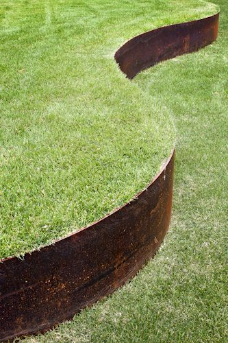 Idea for how to keep a curve in the grass as the slope depends down to the old garage base level