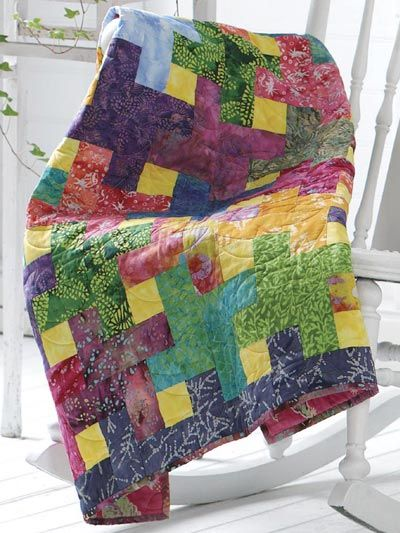 """Simplified Log Cabin:  This colorful 36"""" x 42"""" lap quilt is easy to make. Each Log Cabin block has only five pieces."""