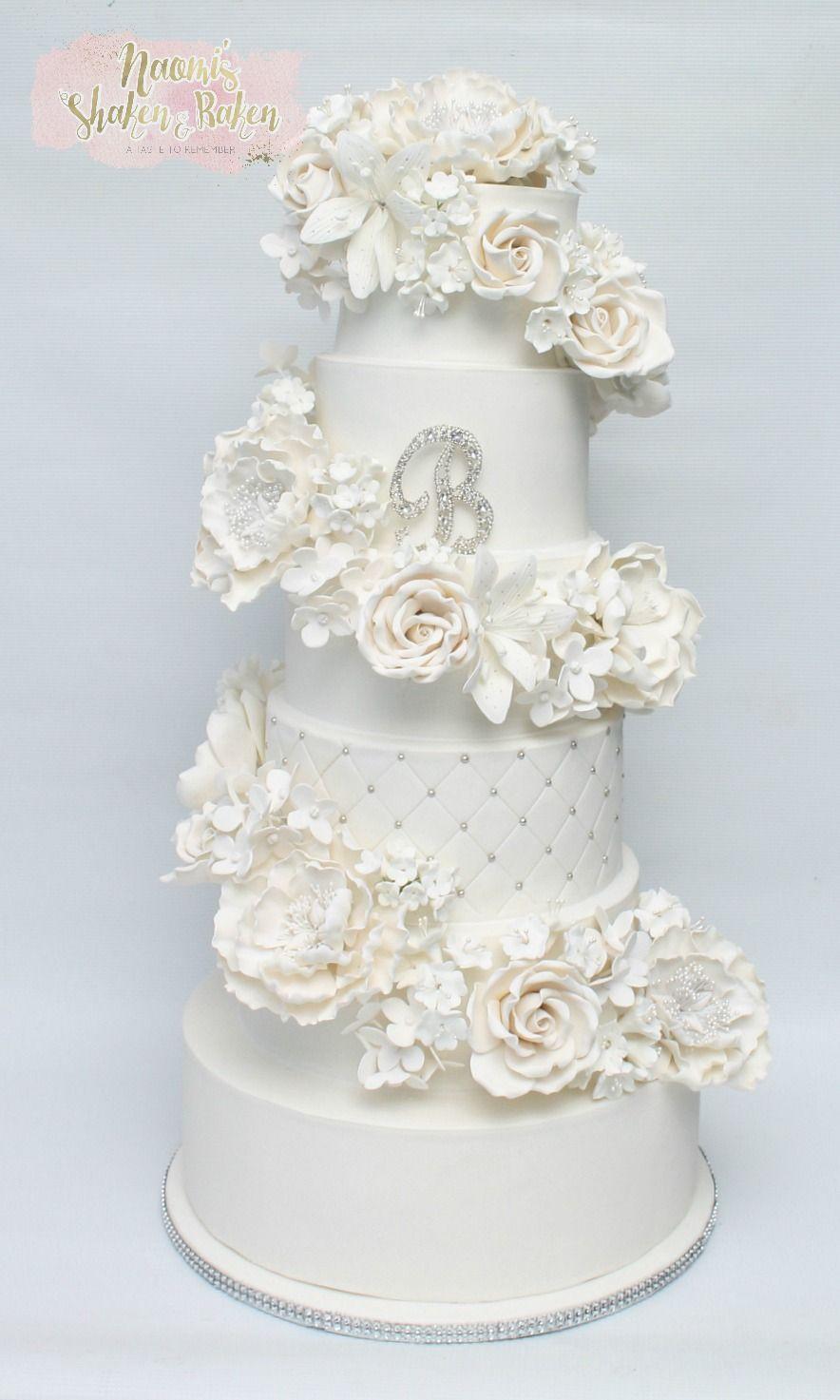 Bec- luxury wedding cake adorned with handmade flowers spiralling ...