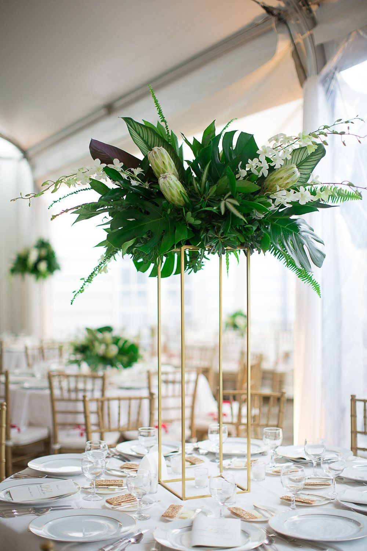 Gatsby inspired art deco event decor Tropical centerpieces White protea white dendrobium