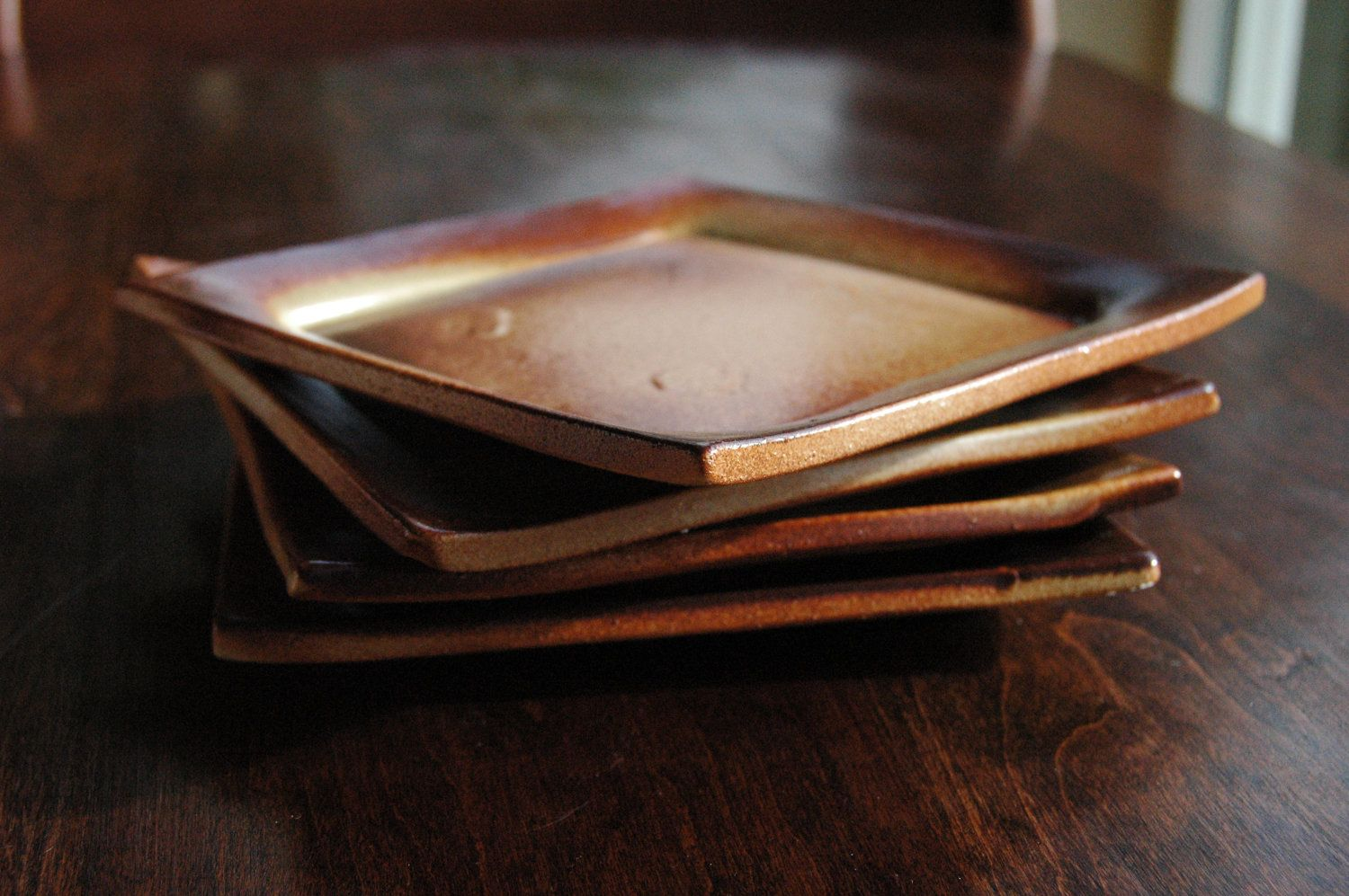"Erin Cartmell-Four Small Rust and Cream ""Nutmeg"" Stoneware Plates. $32.00, via Etsy."