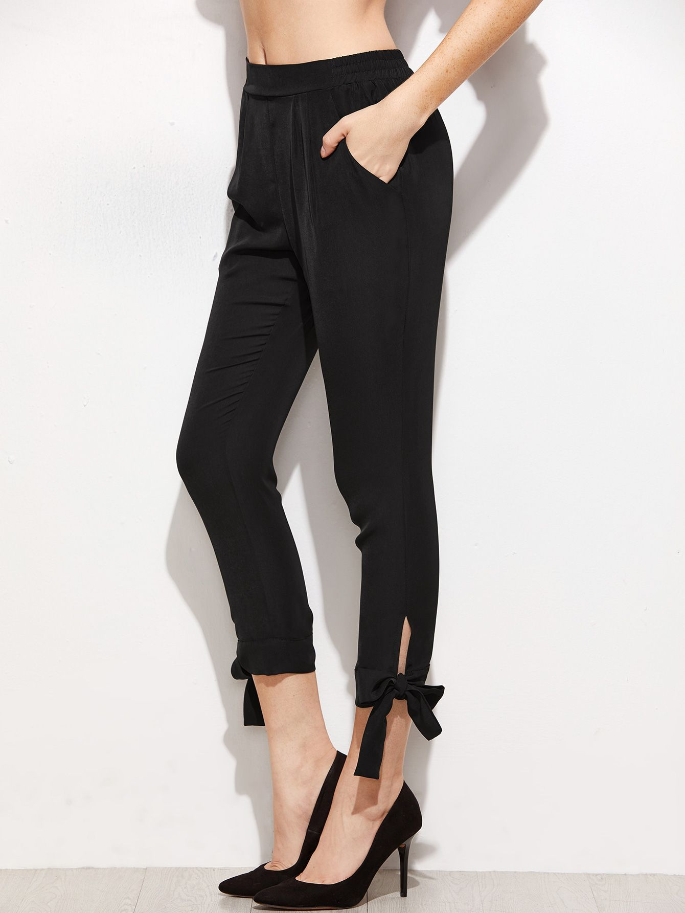 f8c5f9562aba6d Shop Black Bow Tie Hem Crop Skinny Pants online. SheIn offers Black Bow Tie  Hem Crop Skinny Pants & more to fit your fashionable needs.