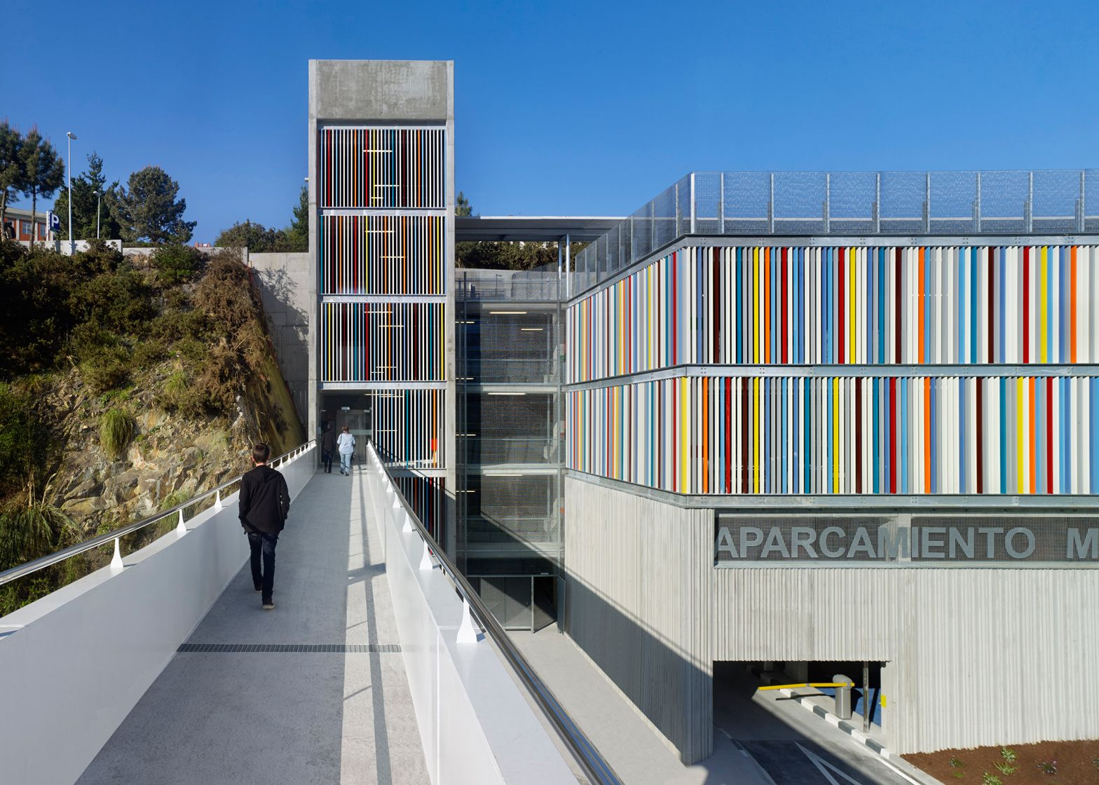Design of basement car parking - Coloured Metal Slats And Textured Concrete Panels Enclose A Hospital Car Park In Spain