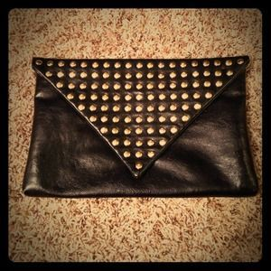 I just discovered this while shopping on Poshmark: AK Steve Madden gold stud clutch. Check it out!  Size: OS