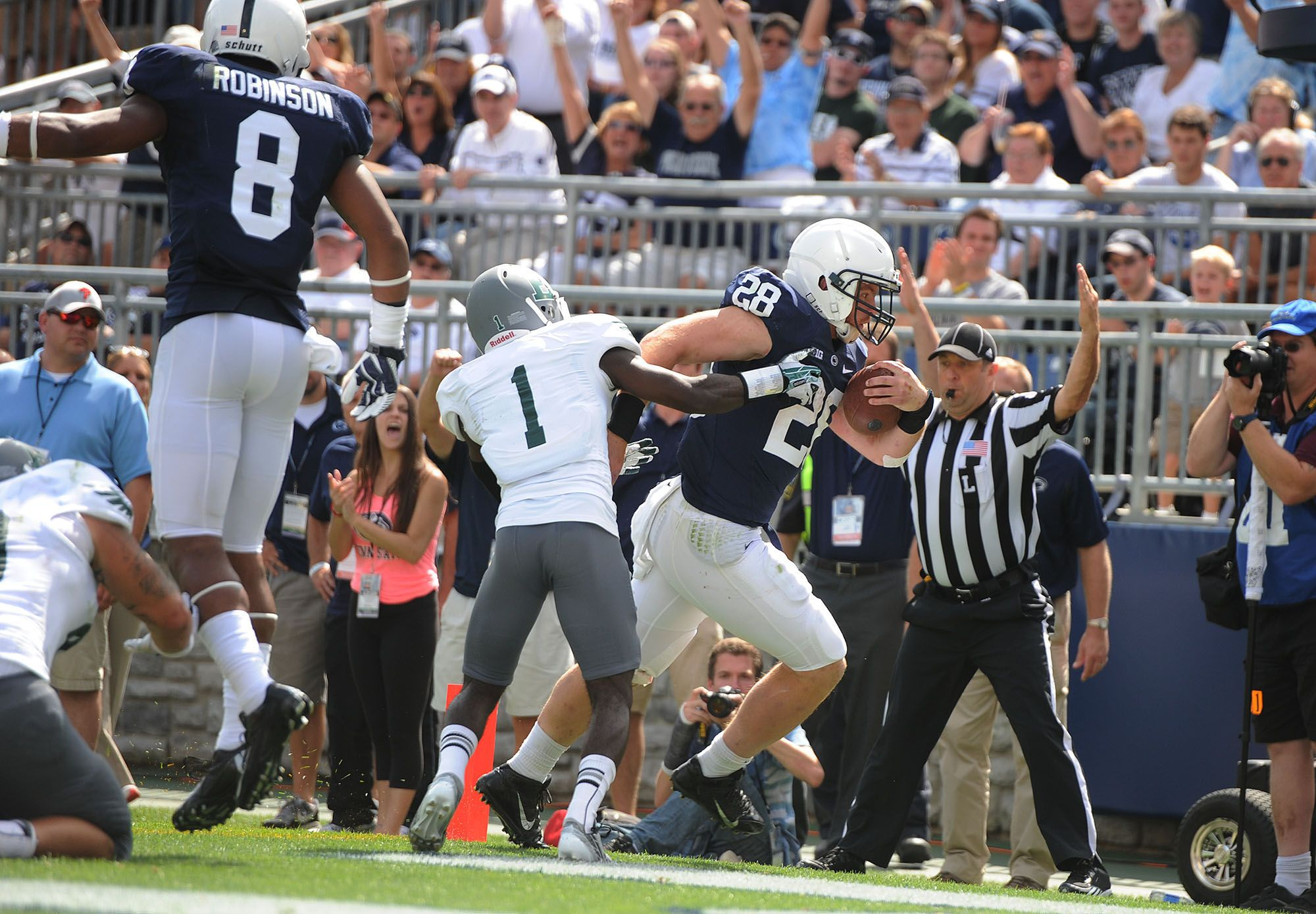PENN STATE – FOOTBALL 2013 – TAILBACK Zach Zwinak races around left end for State's third touchdown Saturday, and Nittany Lion mascot did 24 one-armed pushups.  Penn State vs. Eastern Michigan, September 6, 2013. The weatherman dialed up a perfect day for football in Happy Valley Saturday, and the Nittany Lions did their part to make fans in Beaver Stadium enjoy the delightfully warm, sunny afternoon by running through, over and around Eastern Michigan, 45-7.