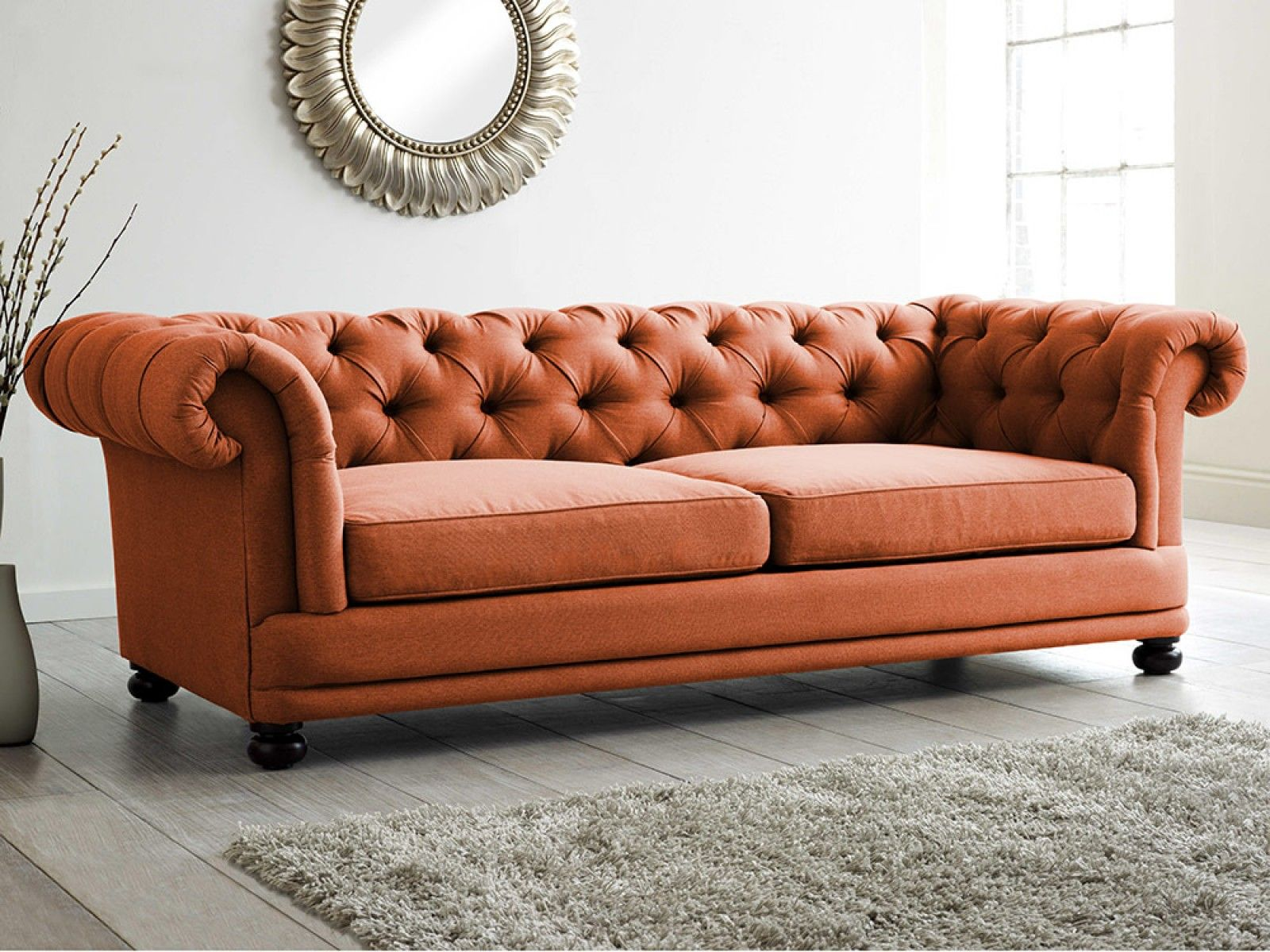 This Vibrant Deep Buttoned Back Sofa Takes A Modern Twist On The Classic Chesterfield Chesterfield Sofa Living Room Upholstered Sofa Chesterfield Living Room