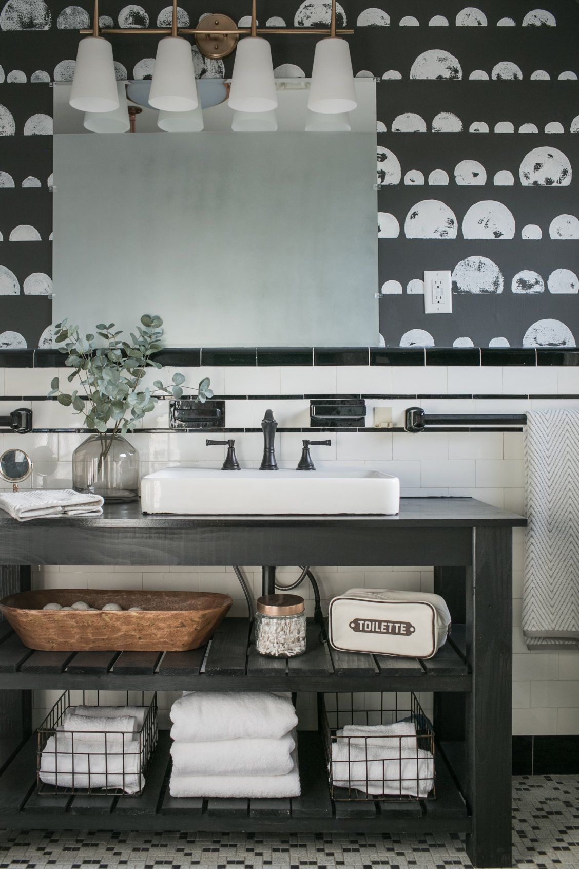 A bell vanity light and vessel sink modernizes a once outdated family bathroom in this episode of The Weekender.
