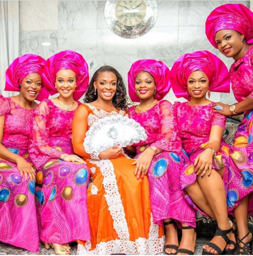 Nigerian bride in orange with her friends in Pink Colorful, Trendy ...