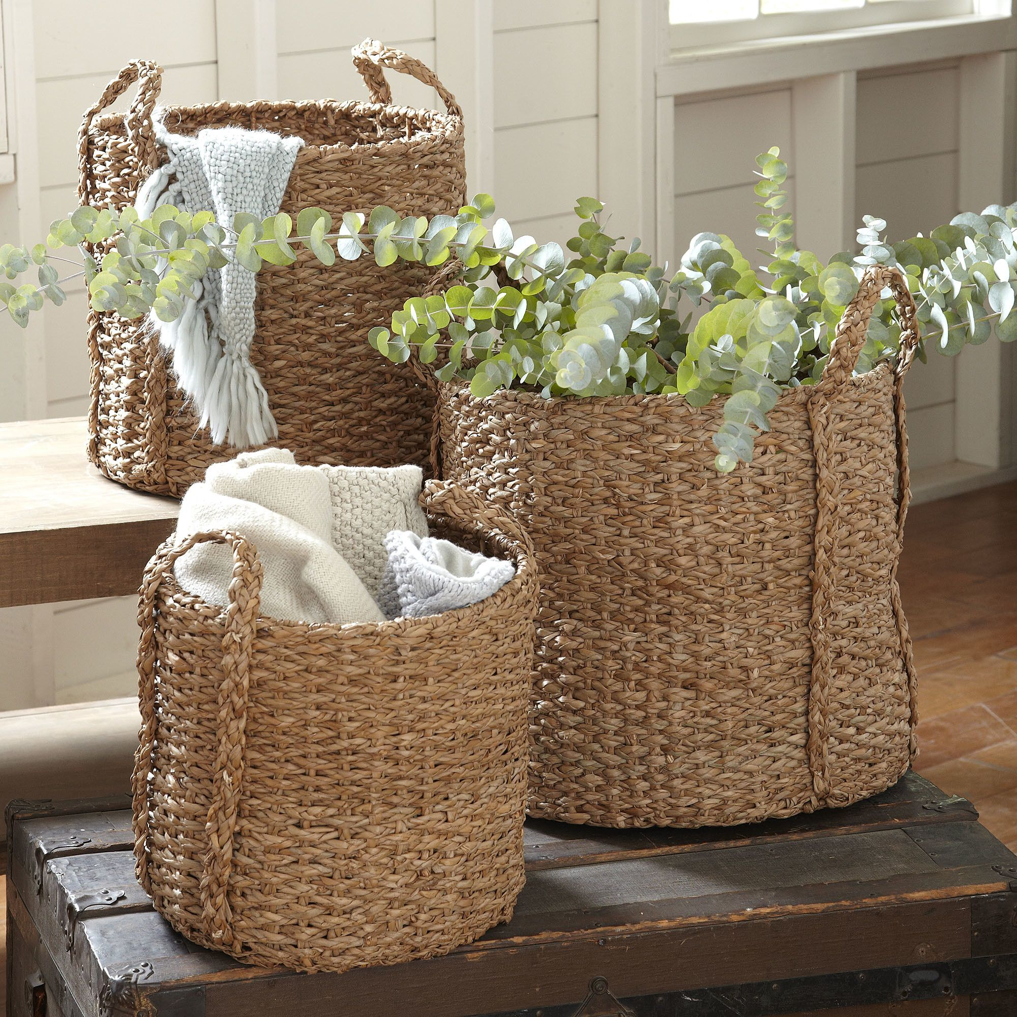 Natural Palm Braided Baskets   Thick braids of natural palm fibers lend classic style to this tote, crafted with sturdy handles and a tightly woven base. Set of three.