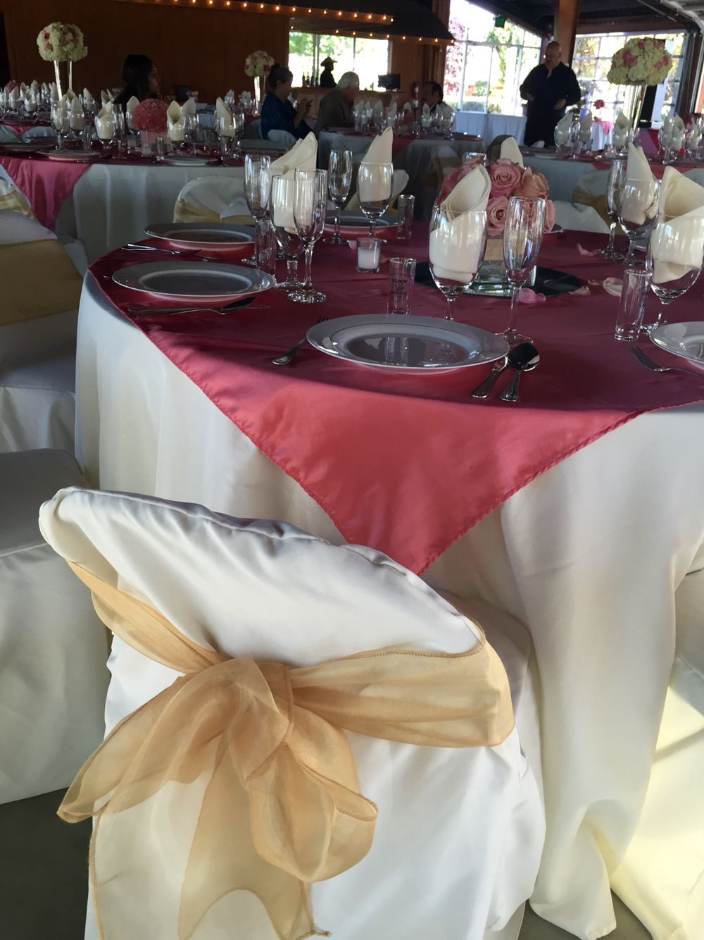 Ivory Table Cloth, Coral Satin Overlay, Gold Chair Bow