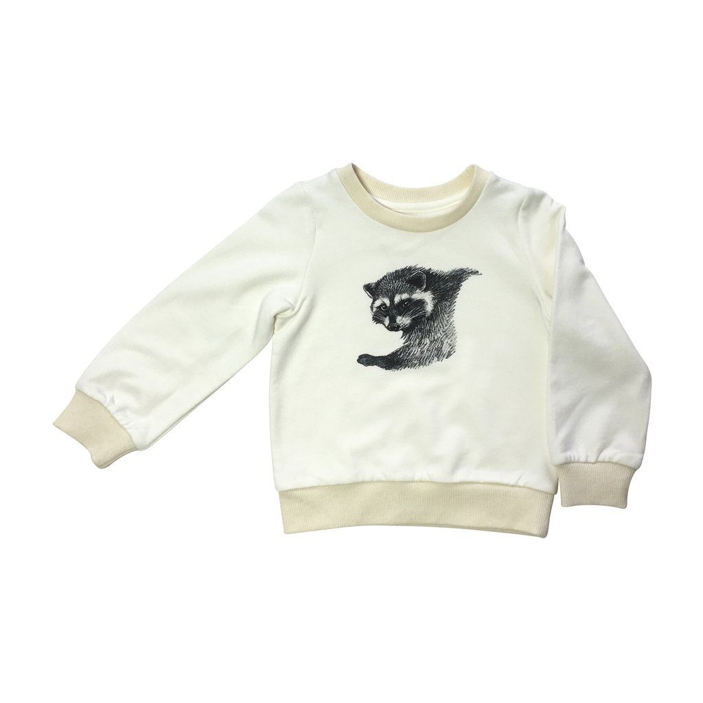 Raccoon Sweatshirt in cream with hand-drawn animal print in the front. The sweatshirt is made from a soft organic cotton and bamboo blend fabric.