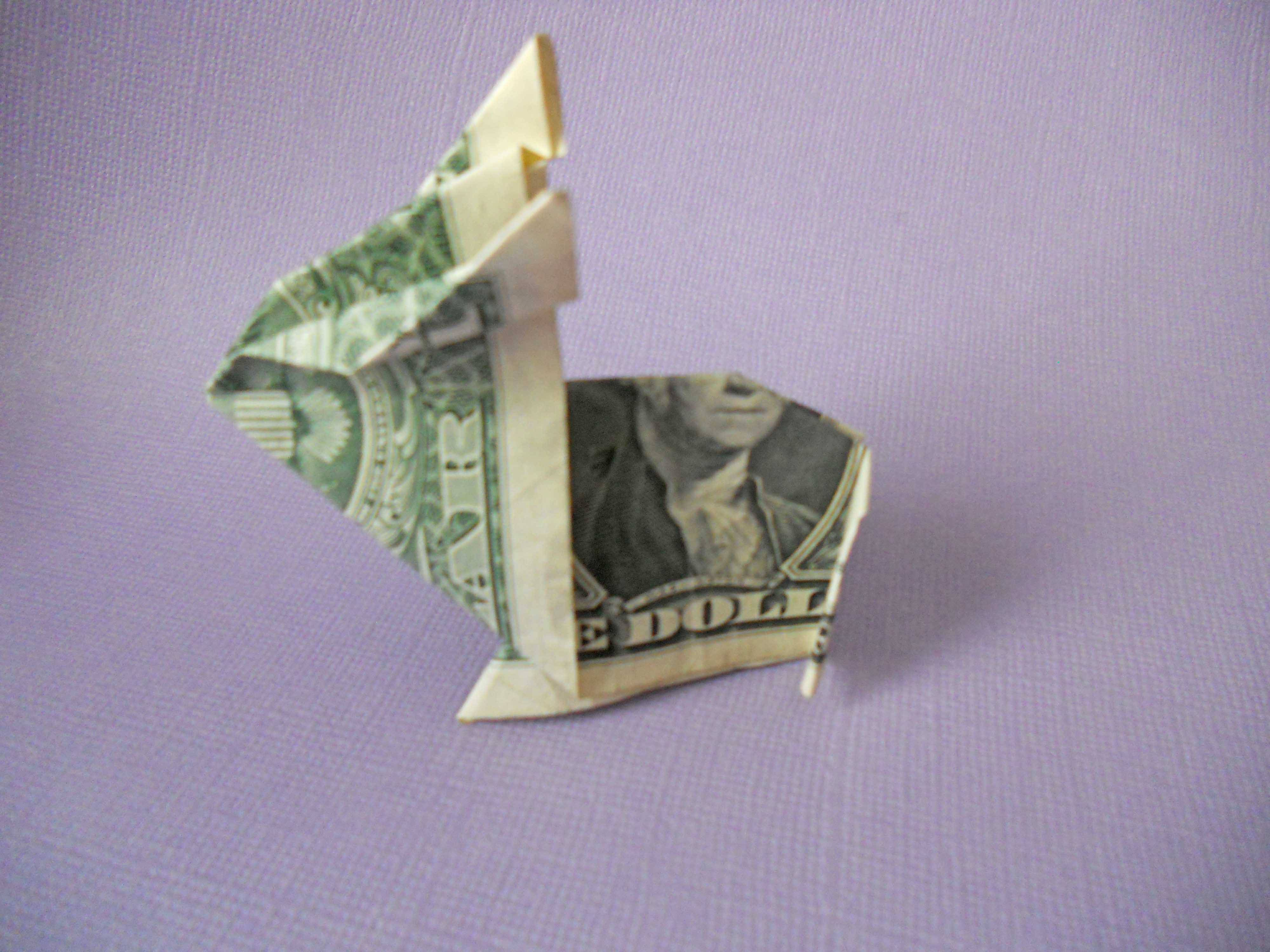 7 simple steps to an adorable money origami bunny origami bunny origami make your origami money bunnys ears jeuxipadfo Image collections