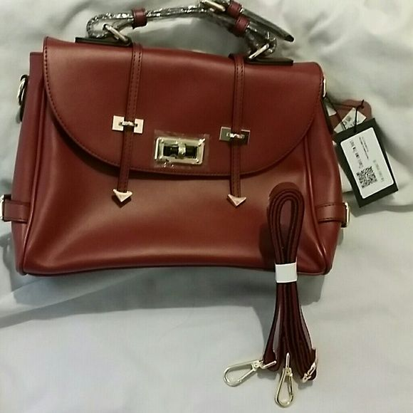 Classy Satchel Bag❣❣NWOT Satchel w removable long strap,back pocket  Spacious inside hold 8 x 10 1/2 magazines, date book.endless You be the talk of the town Chic classy Fine Plus Bags Shoulder Bags